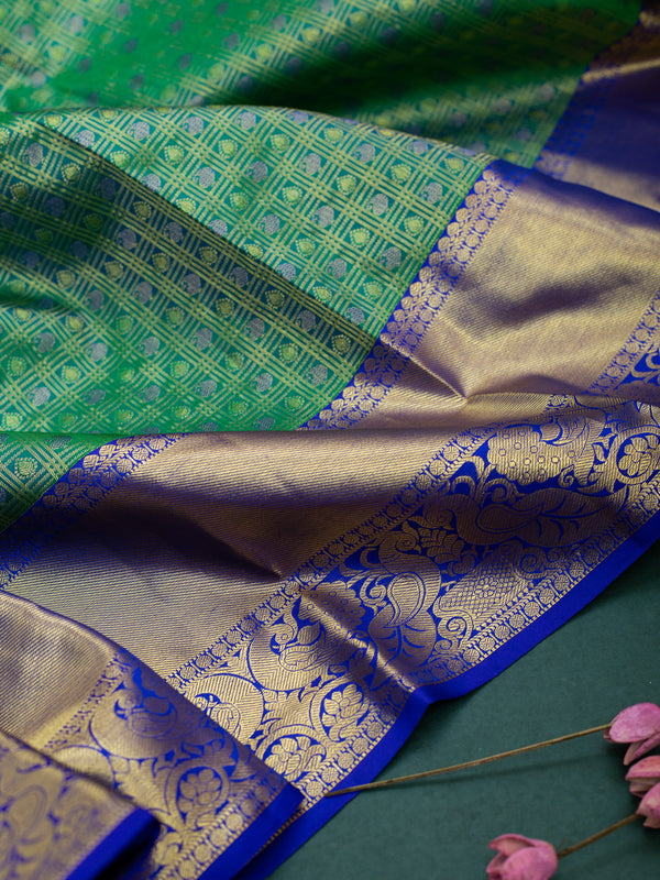 Pure Kanjivaram silk Saree green with violet peocock border and mango zari buttas
