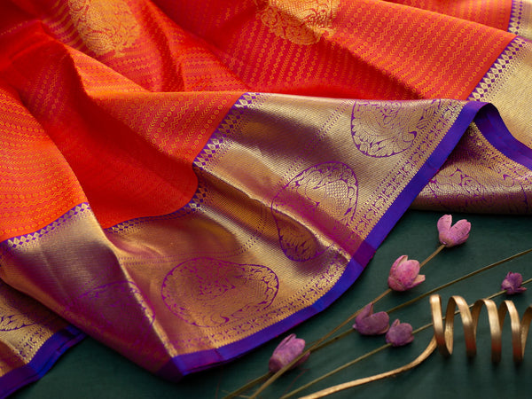 Pure Kanjivaram Silk Saree Orangish pink and blue with self emboss pattern and zari butta