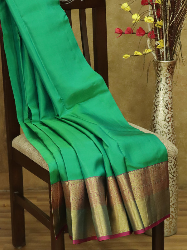 Pure Kanjivaram silk saree parrot green and magenta with plain body and golden zari floral border