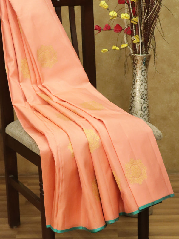 Pure Kanjivaram silk saree peach pink and teal green with floral zari buttas in borderless style