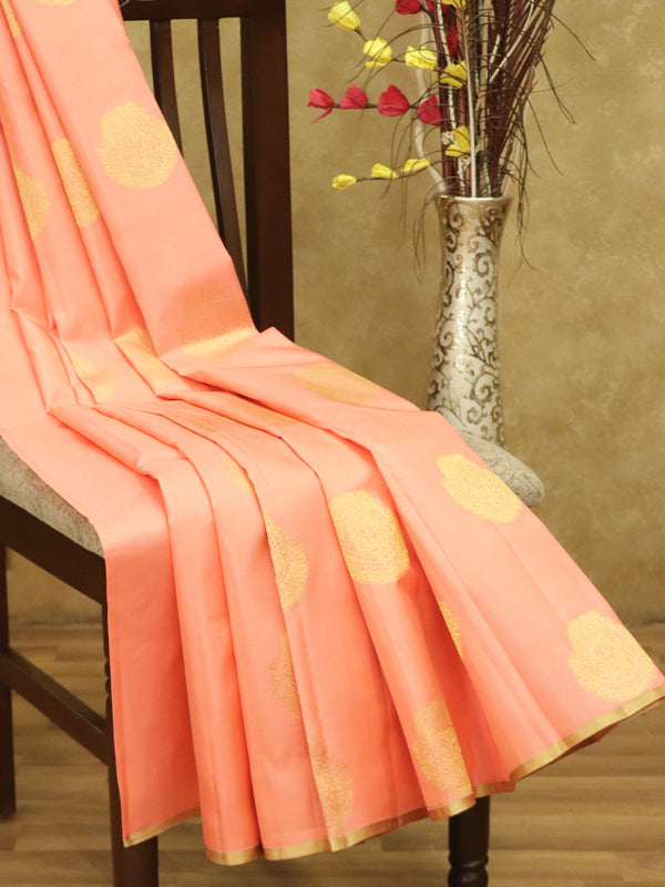Pure Kanjivaram silk saree peach pink and beige with zari buttas in borderless style