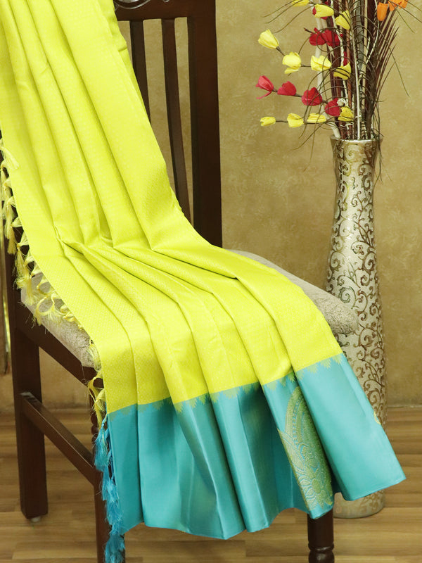 Pure kanjivaram silk sarees fluorescent green and mild blue with allover self emboss and golden zari paisley butta border