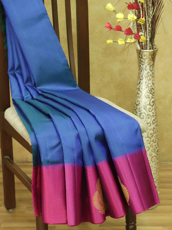Pure kanjivaram silk sarees blue and magenta with allover self emboss and golden zari butta border
