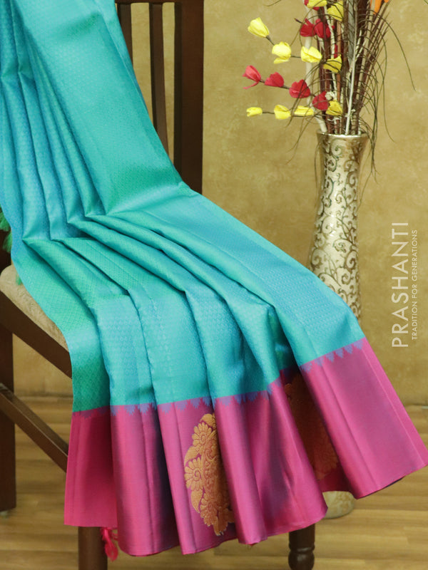 Pure kanjivaram silk sarees dual shade of teal blue and magenta with allover self emboss and golden zari floral butta border