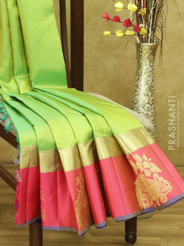 Pure kanjivaram silk sarees fluorescent green pink and blue with allover self emboss and golden zari peacock butta border