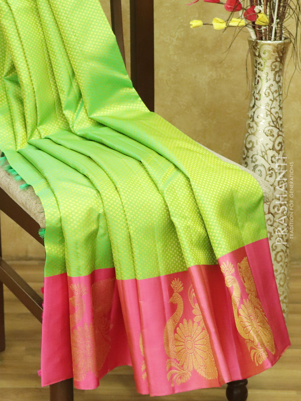 Pure kanjivaram silk sarees fluorescent green and pink with allover self emboss and golden zari peacock butta border