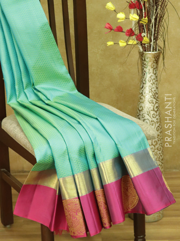 Pure kanjivaram silk sarees dual shade of teal blue and magenta pink with allover self emboss and golden zari round peacock butta border