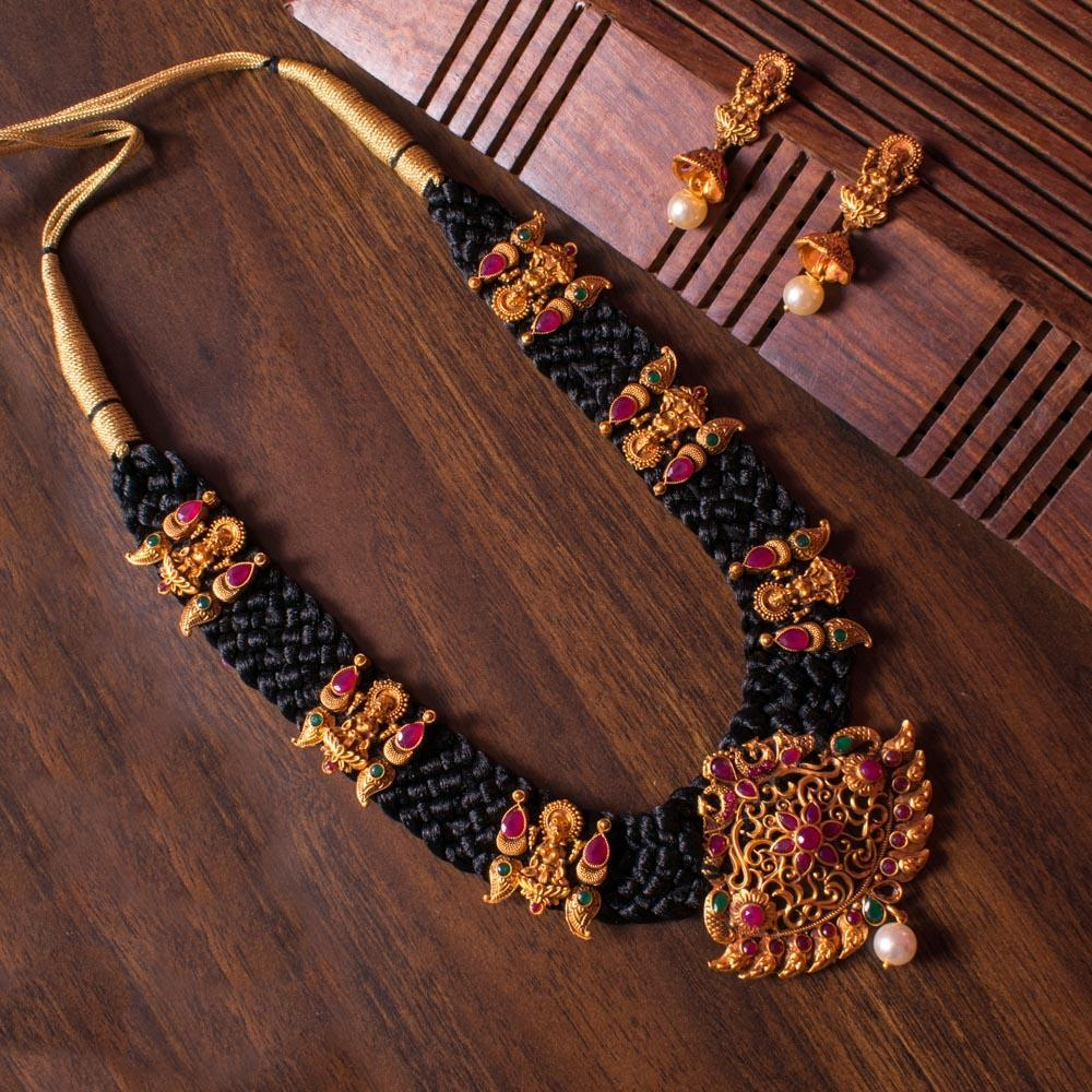 Black woven gold plated laxmi set