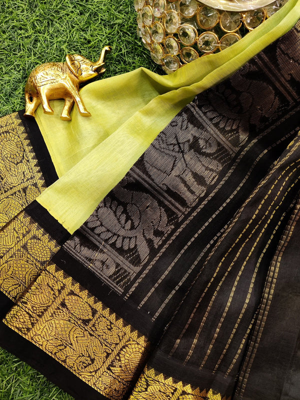 Silk cotton saree green and black with rich korvai zari border