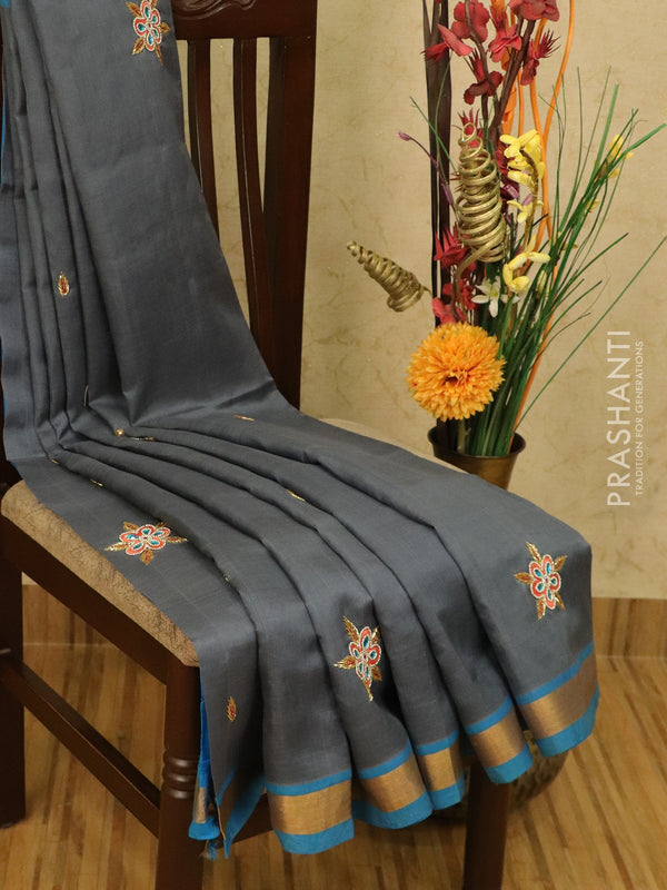 Silk cotton saree grey and cs blue with embroidery work and zari border