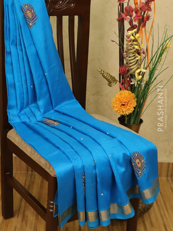 Silk cotton  saree blue with embroidery work and zari border