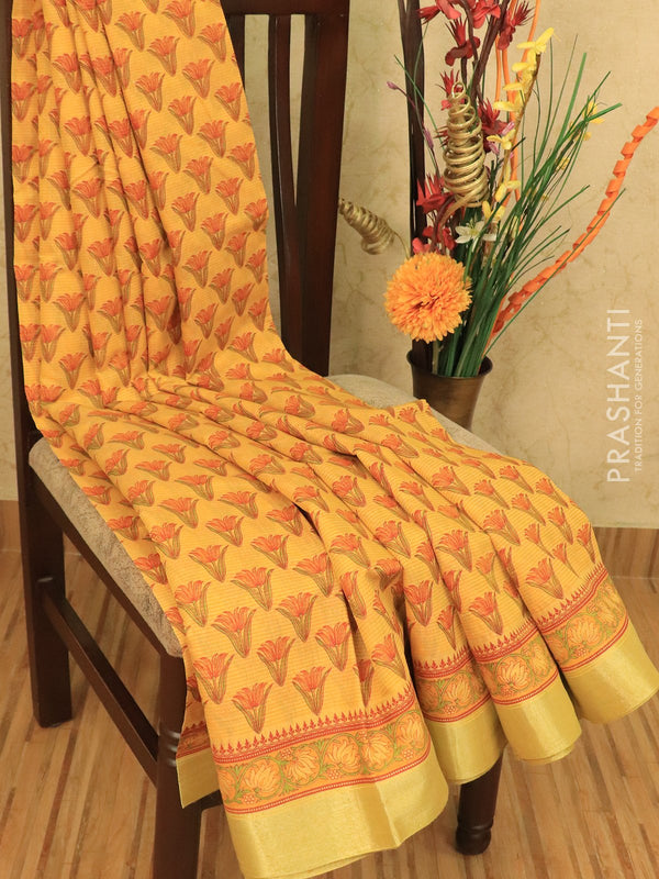 Chanderi cotton saree yellow with allover prints and zari woven border