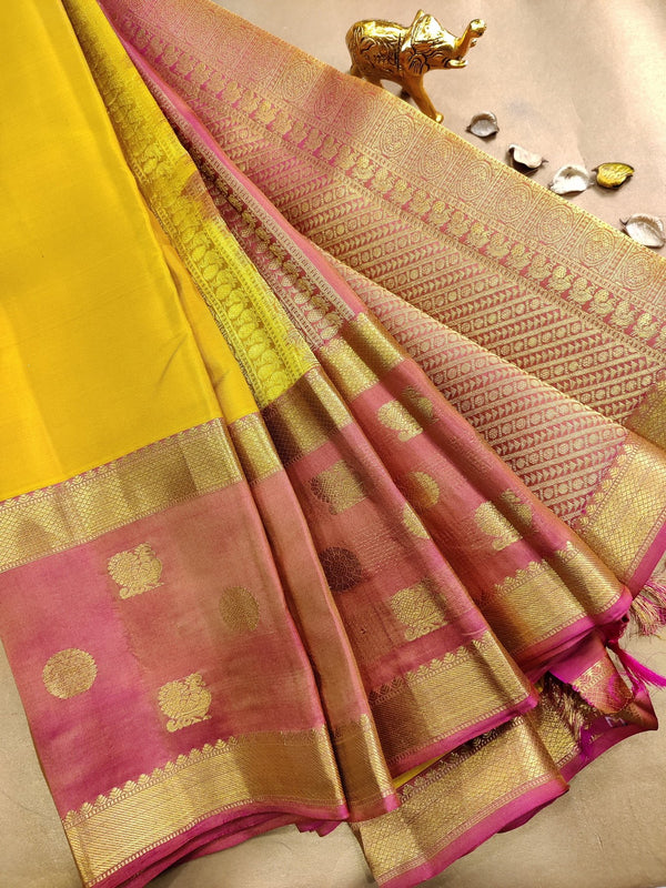 Pure kanchivaram silk saree yellow and pink with plain body and zari woven butta rettapet border