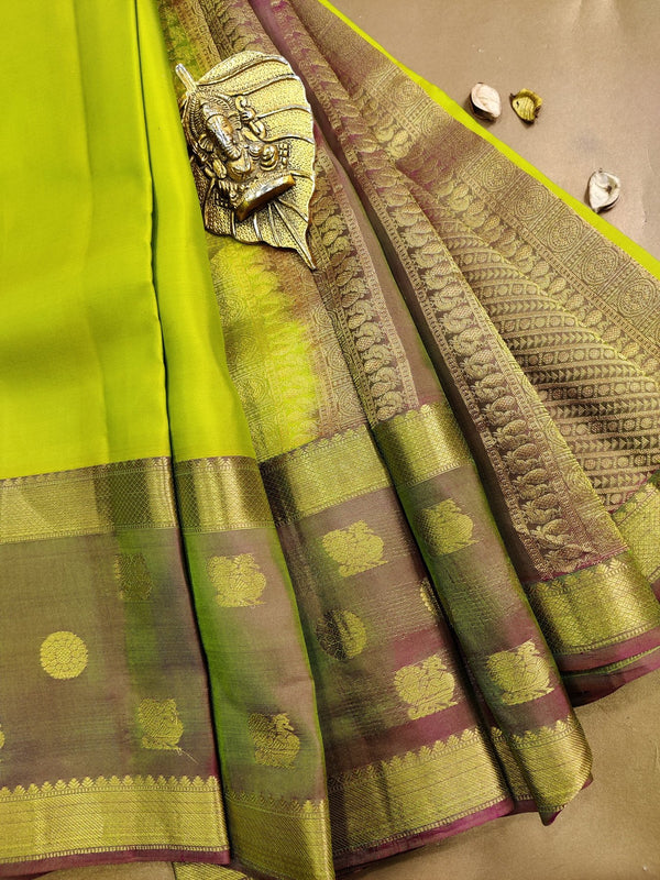 Pure kanchivaram silk saree light green and dual shade of pink with plain body and zari woven butta rettapet border