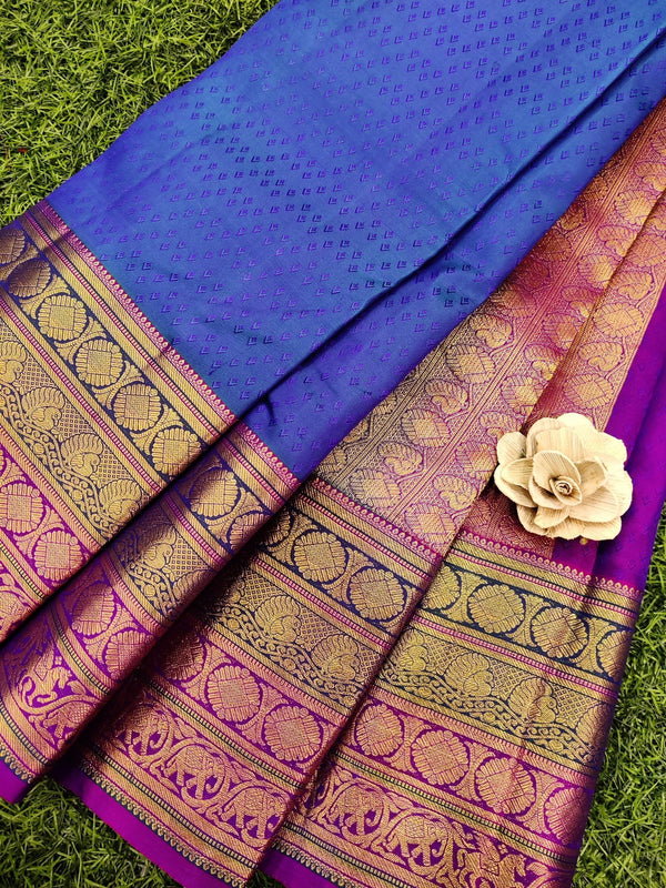 Pure kanchivaram silk saree blue and magenta pink with allover self emboss and rich zari woven border