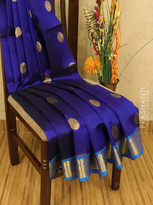 Silk cotton saree blue and cs blue with zari woven coin buttas and zari border