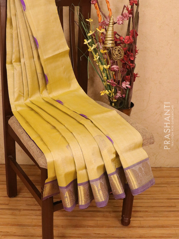Silk cotton saree cream and blue with zari & thread woven buttas and zari woven border