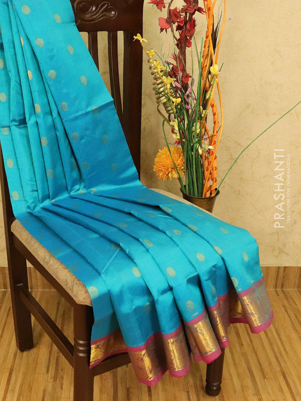 Silk cotton saree blue and pink with zari woven coin buttas and zari woven border