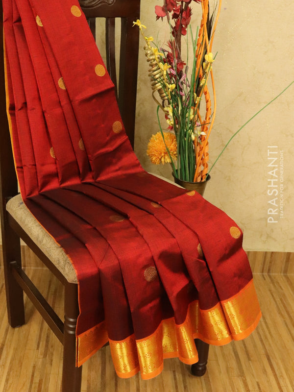 Silk cotton saree maroon and yellow with zari woven coin buttas and zari woven border