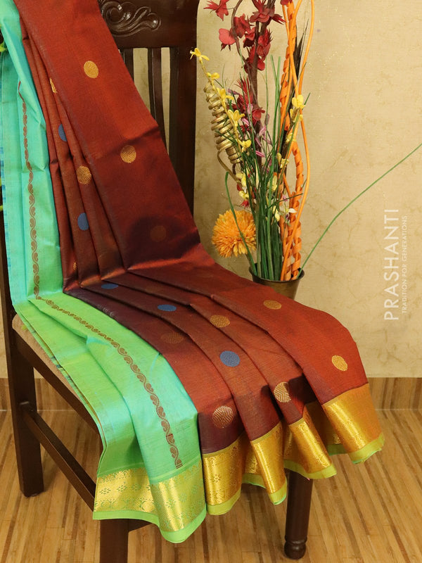 Silk cotton partly saree rustic brown and green with thread and zari woven buttas and zari woven border