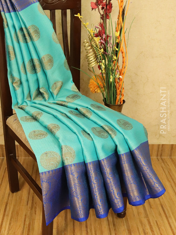 Banarasi kora saree light blue and blue with allover self emboss and zari buttas with zari border