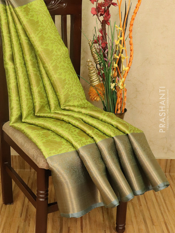 Banarasi kora saree light green and grey with allover zari weaves and rich zari border