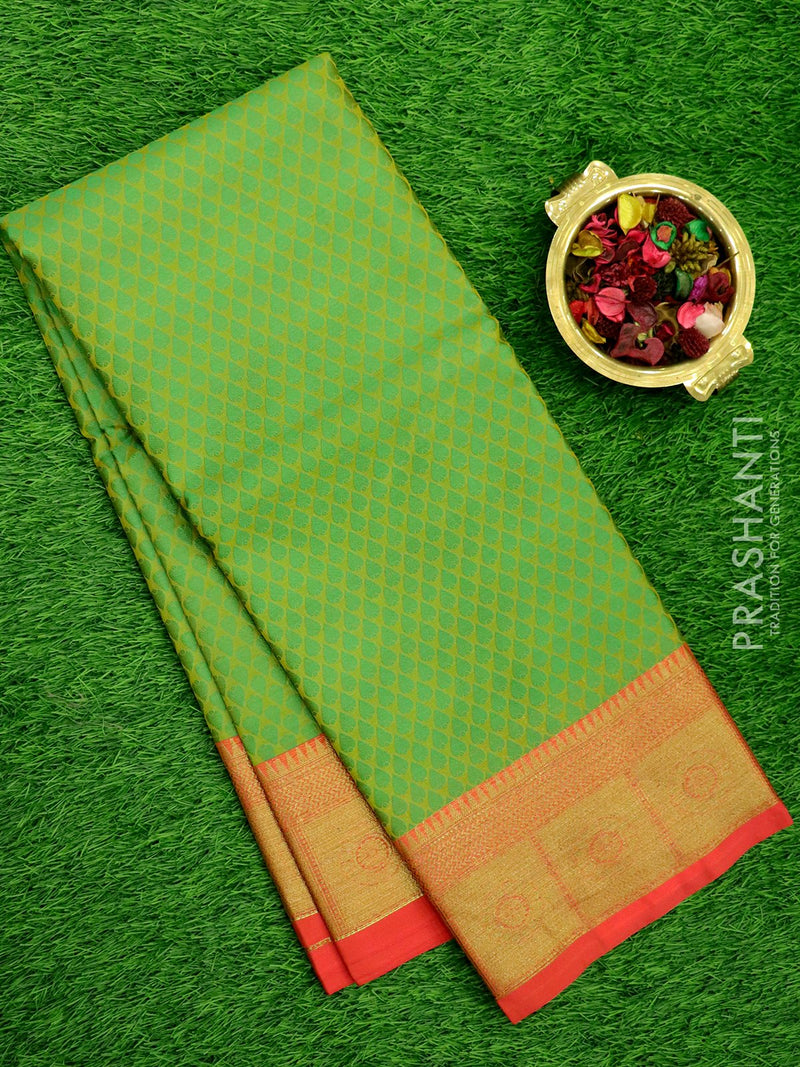 Banarasi Kora Saree green and peach pink with self emboss and kanji style zari border