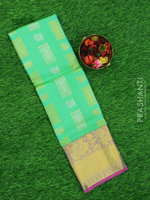 Pure silk pavadai material teal and purple with allover self emboss and zari buttas and rich border for 3 to 5 years
