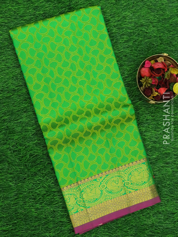Pure silk pavadai material pink and green with allover self emboss and golden zari peacock border for 6 to 10 years