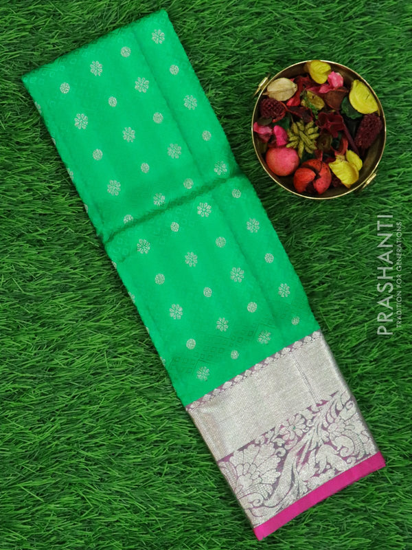 Pure silk pavadai material green and pink with allover self emboss and zari buttas and rich border for 0 to 2 years