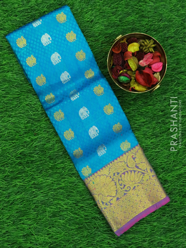 Pure silk pavadai material blue and pink with allover self emboss and buttas with rich zari border for 0 to 2 years