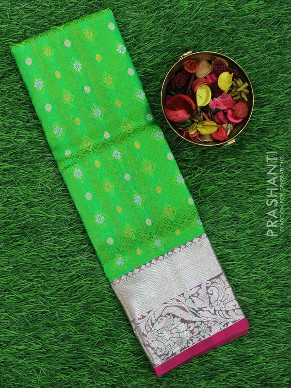 Pure silk pavadai material green and pink with allover self emboss and rich zari border for 0 to 2 years