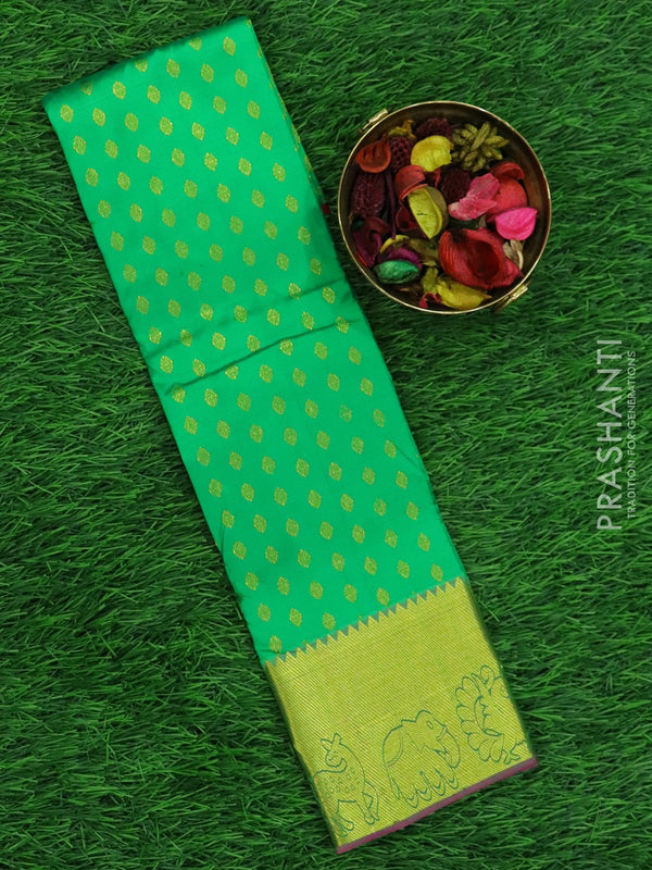 Pure silk pavadai material green and pink with small zari buttas and rich zari border for 0 to 2 years