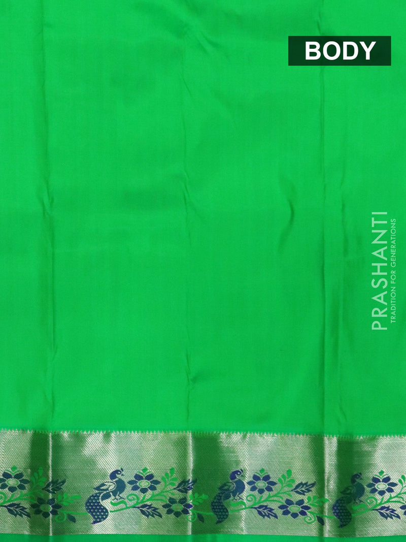Pure silk pavadai material parrot green with plain body and rich zari border for 0 to 2 years