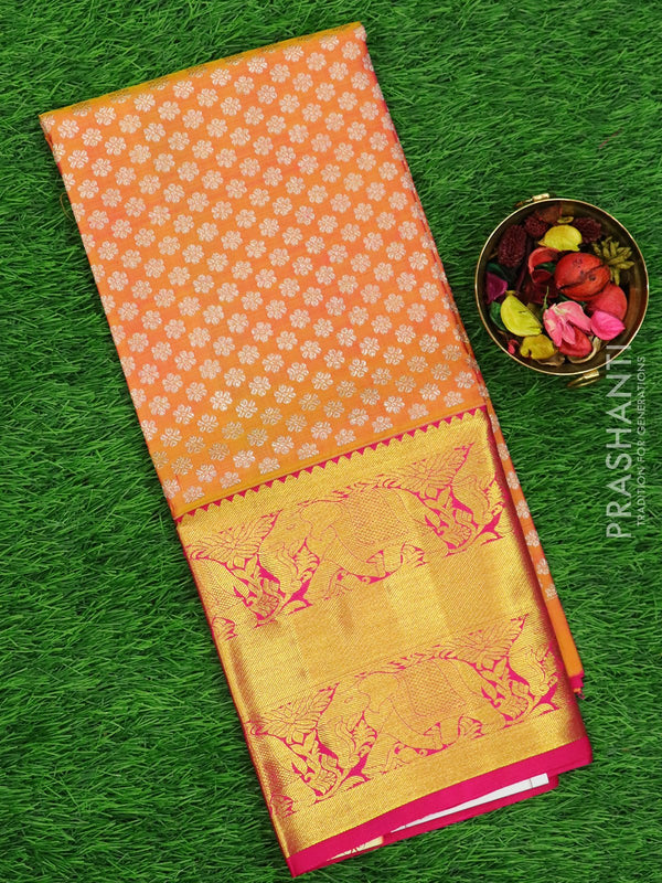 Pure silk pavadai material mild peach and pink with allover floral buttas and rich zari border for 6 to 10 years