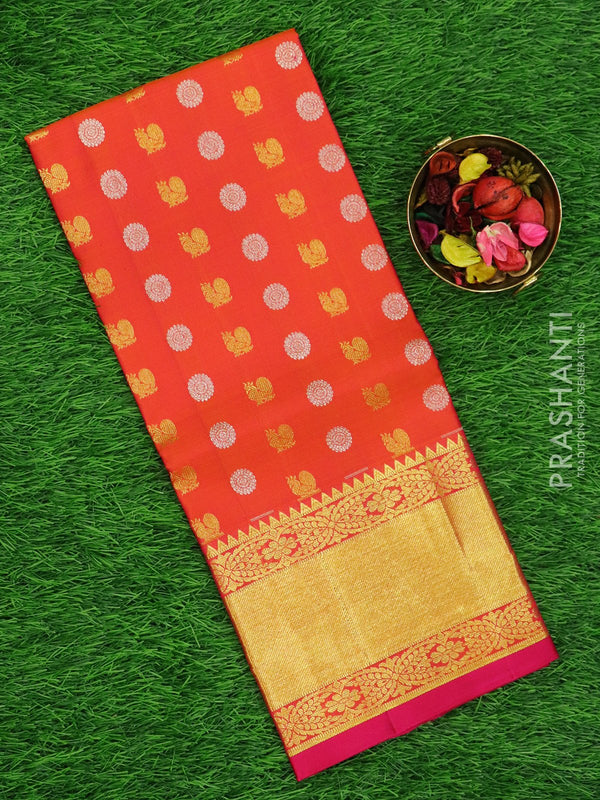 Pure silk pavadai material dual shade of peach and pink with allover floral buttas and rich zari border for 6 to 10 years