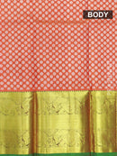 Pure silk pavadai material orange and green with allover floral buttas and rich zari border for 6 to 10 years