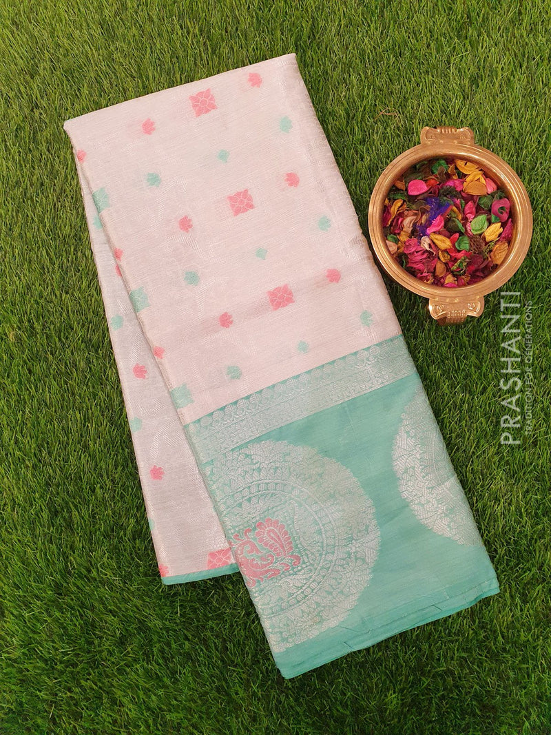 Tissue Banarasi Saree white and teal green with thread and zari woven emboss and butta style border