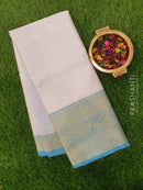 Tissue Banarasi Saree white and blue with allover floral emboss and kanji style border