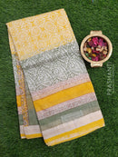 Chanderi Bagru Printed Saree beige and green allover print with maheshwari border