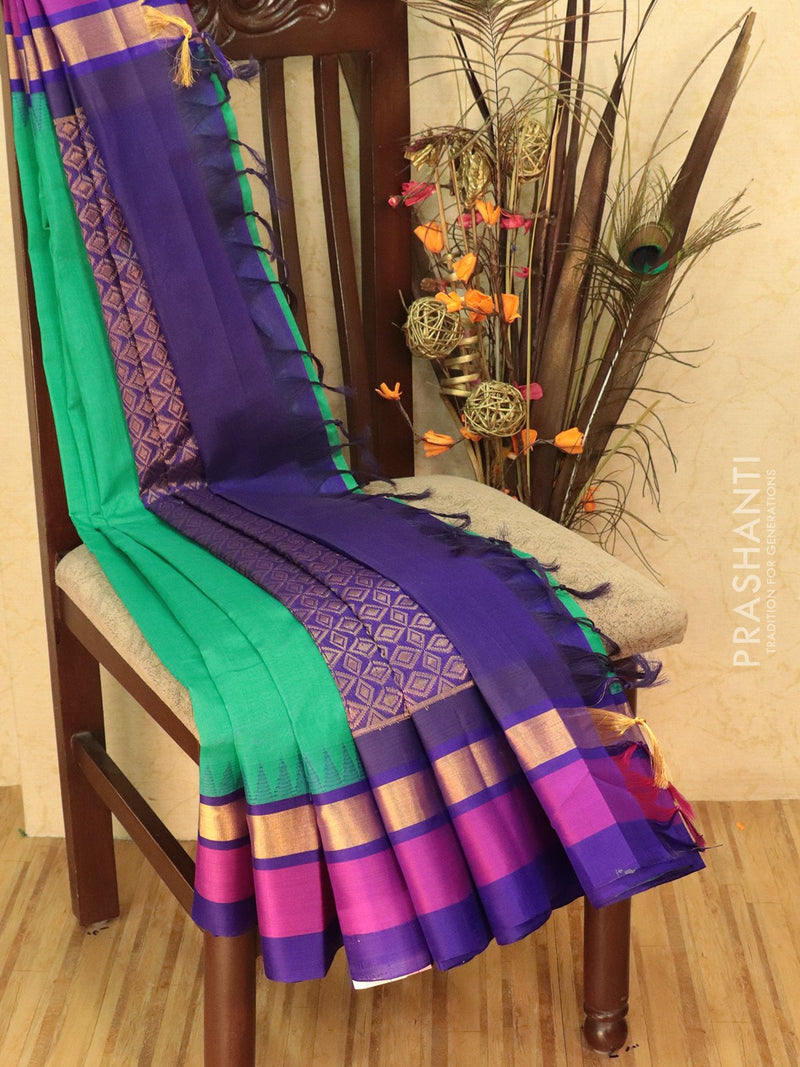 Kuppadam Silk Cotton Saree green and violet with simple zari woven temple border