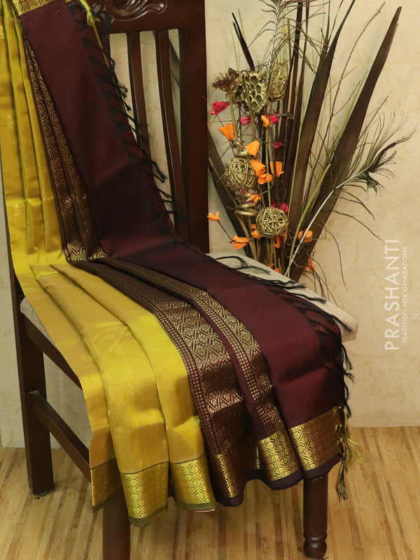 Silk Cotton partly Saree golden yellow and coffee brown with small zari buttas and border