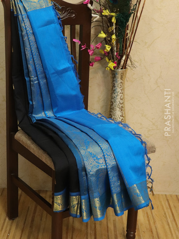 Silk Cotton partly Saree black and cs blue with zari woven buttas and border