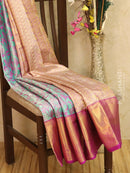 Pure Kanjivaram tissue silk saree light blue and purple with allover floral zari weaves and rich zari woven border