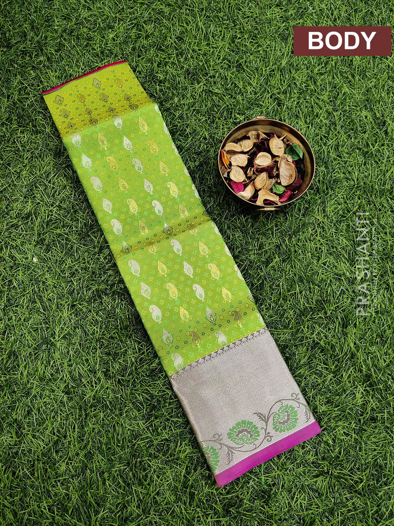 Pure Kanjivaram kids lehanga green and pink with allover self emboss and buttas with woven border for 0 to 2 years