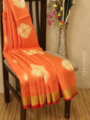 Pure linen saree orange with batik prints and simple border