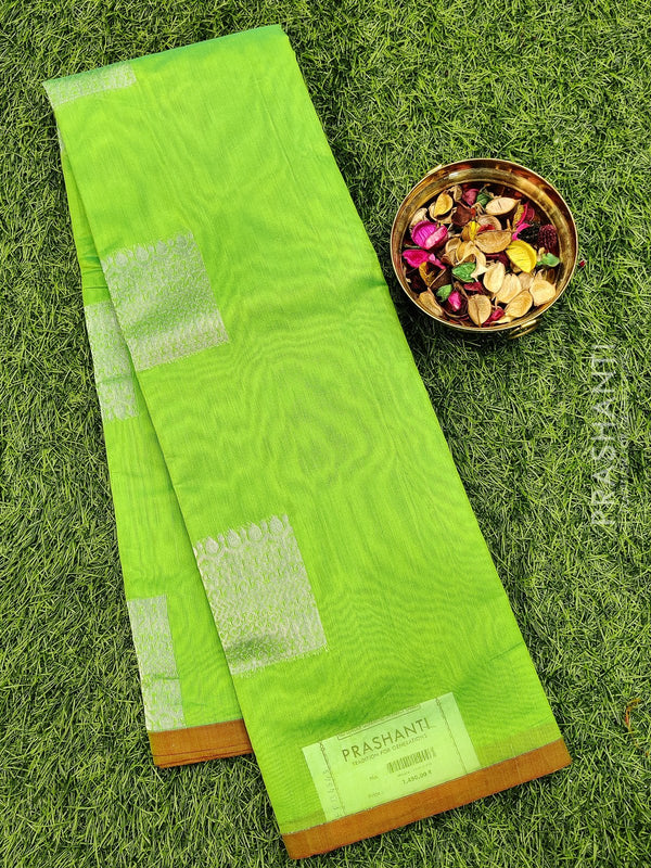 South kota saree lime green with piping border and silver zari buttas