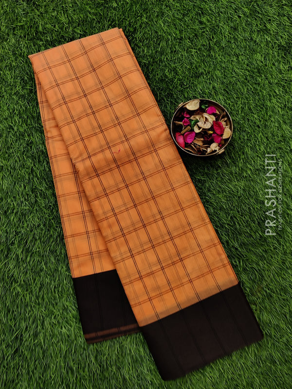 South kota saree peach and black with body checks and plain border