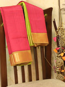 Silk cotton sarees reddish pink and green with simple zari border