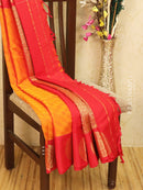 Semi silk saree brick orange and red with self emboss and zari butta border